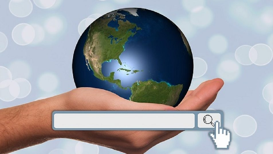 Image of a hand holding the world globe, with internet search bar, illustrating the power of SEO and internet marketing.