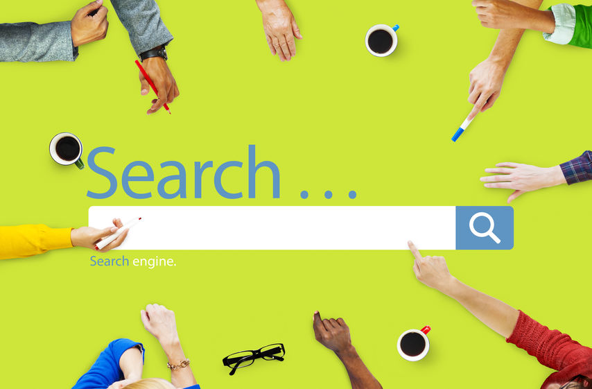 image of several hands pointing at a search engine search bar